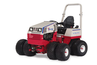 Ventrac 4500Z AWD articulating compact utility tractor left profile - Shown with optional dual wheels, suspension seat, and arm rests.
