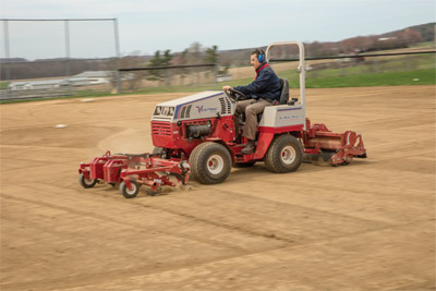 Ventrac 4500 with Renovator & Groomer - The 4500 front and back mount makes it possible to renovate and groom an infield at the same time.
