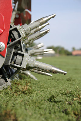 Closeup of Aera-Vator tines - The Aera-Vator is designed to displace the soil leaving behind only holes and no plugs.