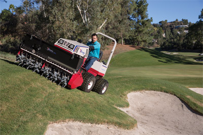 The Aera-Vator with Seeder at work - Safer and efficient performance on slopes.