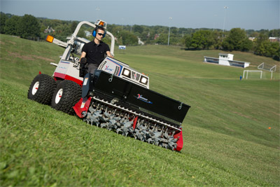 Ventrac 4500Z with the Aera-Vator - The Aero-Vator, shown here with optional seeder mounted on top, aerates without tearing up the turf.
