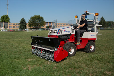 Ventrac 4500Z compact utility tractor with Aero-Vator - Aero-Vator shown with optional seeder and 4500Z shown with optional propane kit.