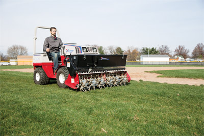 Aera-Vator and optional Seeder on the Ventrac 4500 - The healthiest lawns are lawns that are properly aerated and well seeded. Ventrac makes it possible with the Aera-Vator and seeder.