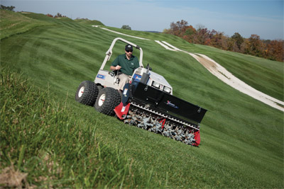 Ventrac Aera-Vator and Seeder on Slope - Aerating your lawn on hills and slopes made possible and safe by Ventrac.