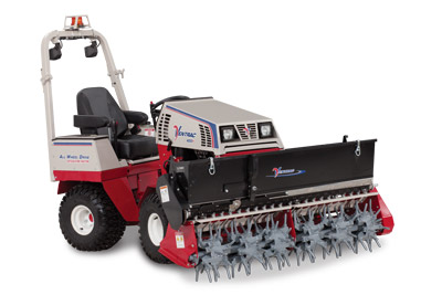 Ventrac 4500Y with Aera-Vator and Seeder - Shown with optional mounted LED lights and safety strobe light