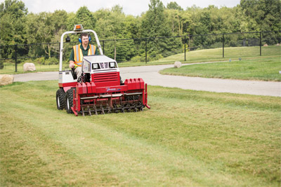 Ventrac 4500 with Aerator - Shown using the slitter/slicer tines.