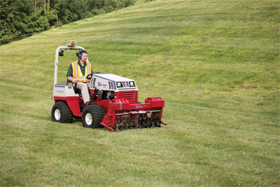 Ventrac 4500 with core tine aerator - Aerate your turf quickly and easily.