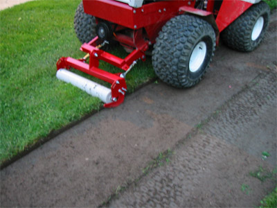 Closeup of Sod Cutter in use - The Sod Cutter for the Ventrac 4500 cuts evenly and completely for precise sod removal.