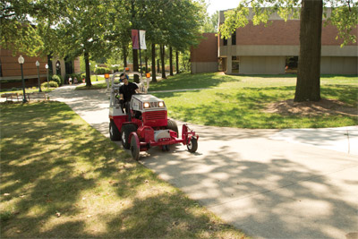 Ventrac 4500 and Sidewalk Edger - Cutting edges around driveways and sidewalks, even on large college campuses, is easy with the Ventrac 20 inch Edger.
