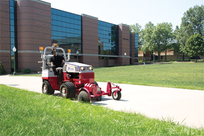 Ventrac 4500Z articulating tractor with Edger - The 20 inch edger is shown with optional blower.