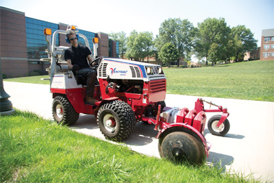 Ventrac 4500Z with 20 inch Edger - 4500Z shown with optional mounted LED lights, safety strobe light, and directional/hazard lights. Edger shown with optional suitcase weights.