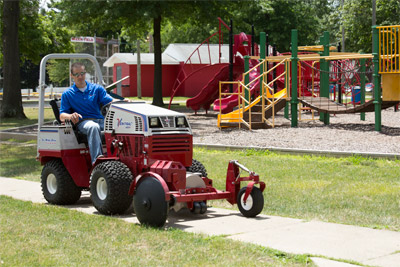 Ventrac 4500 using 20 inch Edger - Shown with optional weights to help maintain constant down pressure for an even cut.