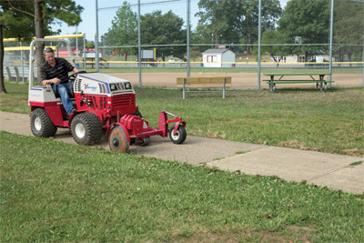 "Ventrac 4500P using 20 inch Edger - The 20"" Edger is large enough to cover more ground in less time."