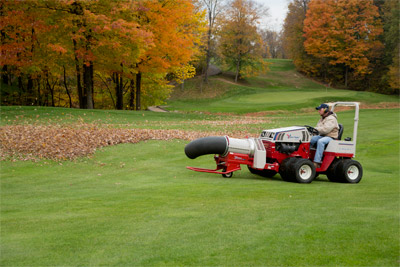 Ventrac 4500P and Turbine Blower - Shown with optional dual wheels, the 4500 uses the Turbine Blower to completely remove fallen leaves from a golf course leaving only green grass behind.