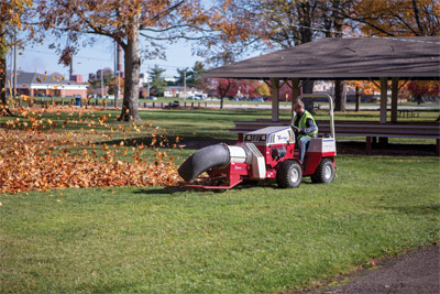 Ventrac 4500 using the Turbine Blower - Adjustable direction and rotation allows the Turbine Blower to clear debris faster and over various distances for more controlled collection and removal.