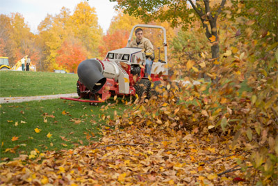 Ventrac 4500Y clearing leaves with the Turbine Blower - Up to 175 MPH of forced air with multi-directional aim is a quick and precise way to clear the ground of fallen leaves.