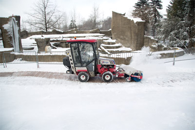 Ventrac 4500Z tractor equipped to battle winter weather - 4500Z shown here with optional propane kit, fully enclosed heated cab, power broom, and broadcast spreader.