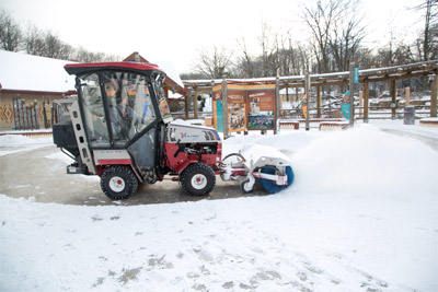 Ventrac 4500Z compact utility tractor - 4500Z shown here with optional propane kit, fully enclosed heated cab, power broom, and broadcast spreader.