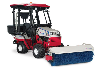 Ventrac 4500 with Winter Accessories - Ventrac 4500 shown with Power Broom, fully enclosed heated cab, and drop spreader.
