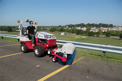 Ventrac 4500Z tractor with Power Broom - The power broom makes cleaning large surface areas like parking lots simple and saves time.