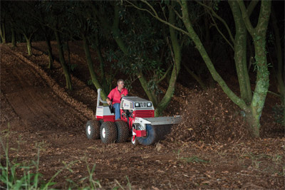 Ventrac 4500 with Dual Wheels and Power Broom - Clearing paths on a Macadamia Farm in Australia.