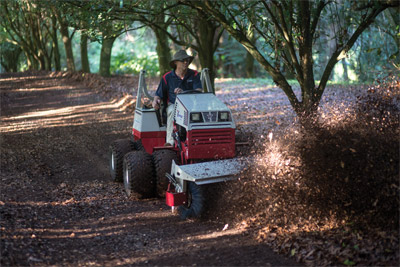 Ventrac 4500 fitted with Dual Wheels using Power Broom - Faster and easier than using a blade, the 4500 with Power Broom clears the way on a Macadamia Farm in Australia.