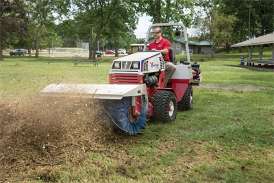 Ventrac 4500 Cleaning Yard with Power Broom - The Power Broom can be used for a variety of different materials from snow to mulch.