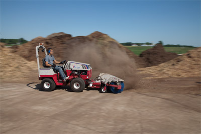 Ventrac 4500Y diesel compact utility tractor with Power Broom - The power broom cleans up mulch spills and overflows fast.