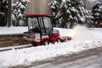 Ventrac 4500Z with Winter Ready Setup - Featuring the HB580 Broom, SA250 Salt Spreader, and the KW450 Cab.
