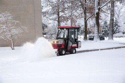 Ventrac 4500 Clearing Snow - Operators can stay warm and dry while battling winter thanks to an enclosed heated cab.