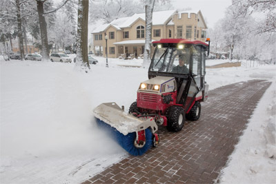 Ventrac 4500Z using Power Broom for Snow - The Power Broom gets right down to the pavement level in a way that blades cannot for a more complete snow removal.