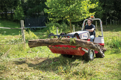 Ventrac 4500 using Power Bucket with Grapple - The optional Grapple for the Power Bucket even makes moving felled trees easier.