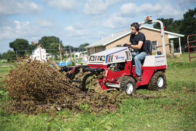 The Ventrac 4500 using the Power Bucket with optional Grapple - Maintaining your yard with the Power Bucket and Grapple on the Ventrac saves time and work moving piles of brush, branches, cuttings, leaves, and such easier than using a wheel barrow.