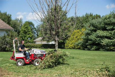 Ventrac 4500 and Power Bucket - Move piles of brush and tree branches in one trip with the Power Bucket and optional Grapple.