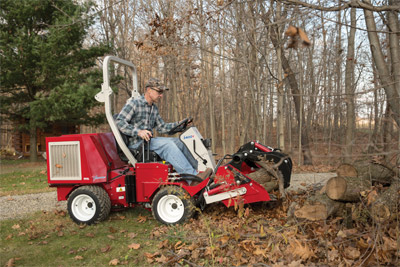Ventrac 3400 with Power Bucket - Moving around piles of firewood is easier with the Power Bucket.