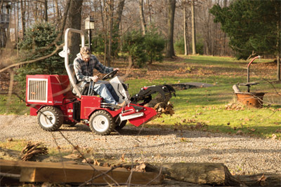 Ventrac 3400 using Power Bucket - The Power Bucket on your Ventrac is the best wheel barrow you'll ever have.