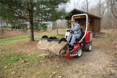 Ventrac 3400 using the Power Bucket - Using the optional grapple the Power Bucket becomes even more versatile.