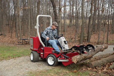 Ventrac 3400 with optional Grapple on Power Bucket - No more need struggling with chains or ropes and dragging large tree limbs and the like when you have the Power Bucket and Grapple to more easily handle those loads.