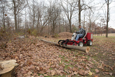 The Power Bucket with Grapple on a Ventrac 3400 - Objects like a fallen tree that would require two people and a lot of chain to move are more safely and easily handled with the Ventrac using a Power Bucket and optional Grapple.