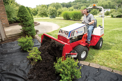 Power Bucket on the Ventrac 4500 - The Power Bucket allows for precise placement of materials to prevent damage to shrubs and flowers while saving you from the heavy lifting.
