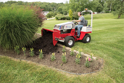 Ventrac 4500 with the Power Bucket - Better than a wheel barrow the Power Bucket delivers mulch where you want it saving you time and making your work load lighter.