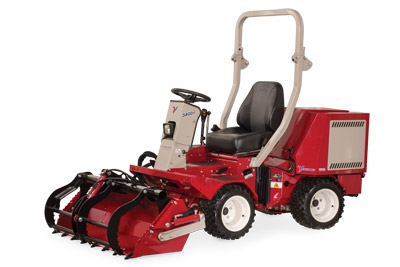 Ventrac 3400 with Power Bucket and Grapple closed and lowered - Shown with optional Grapple and Cutting Teeth.