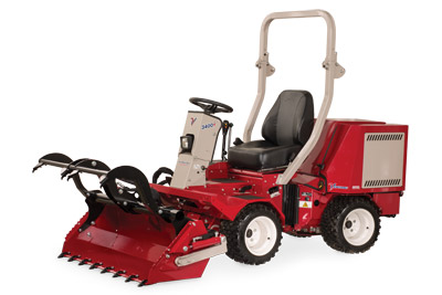 Ventrac 3400 with Power Bucket and Grapple lowered fully extended - Shown with optional Grapple and Cutting Teeth.
