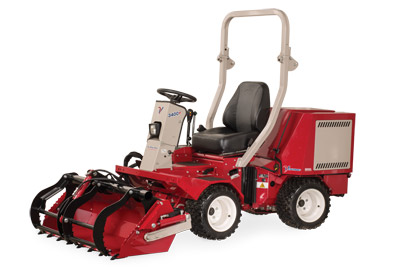 Ventrac 3400 with Power Bucket and Grapple left side view - Shown with optional Grapple and Cutting Teeth.