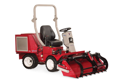 Ventrac 3400 with Power Bucket and Grapple lowered right side view - Shown with optional Grapple and Cutting Teeth.