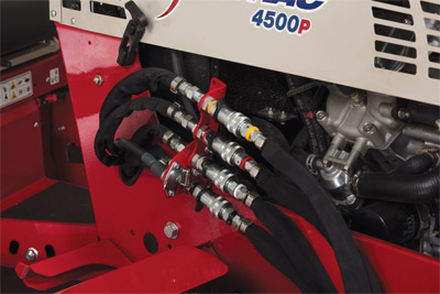 Closeup of Front Hydraulic Aux Kit Hose Assembly - Optional kit that adds two more hydraulic ports to allow for more functions for certain attachments on the front of the Ventrac.