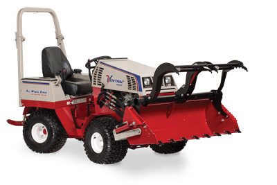 Ventrac 4500 Power Bucket with Grapple lifted and fully extended - Shown with optional Grapple and Cutting Teeth