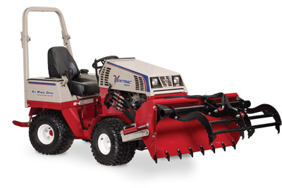 Ventrac 4500 with Power Bucket dumped grapple open - Shown with optional Grapple and Cutting Teeth.