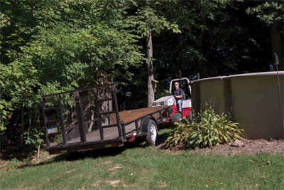 Ventrac 4500 Maneuvers Trailer into Tight Spot - Maneuvering trailers into tight places is possible with the Ventrac Trailer Mover where trucks and larger tractors would never go.