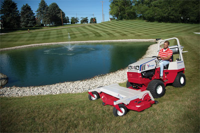 Ventrac 4500 articulating tractor with 72 inch mower - For tight maneuvering around precarious places, Ventrac does it efficiently and safer.